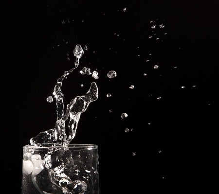 clear water splash on black background Stock Photo - 12176929
