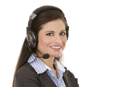 beautiful brunette wearing headset phone on white background Stock Photo - 12176953