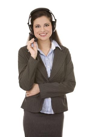 beautiful brunette wearing headset phone on white background photo