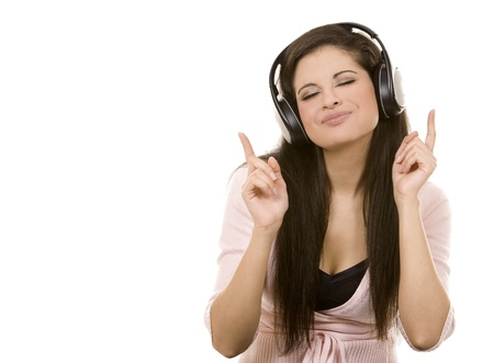 beautiful brunette listening to music on white background photo