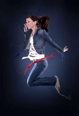 beautiful dancer having fun on dark background