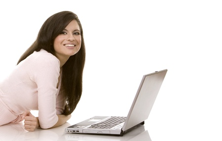 chat online: beautiful brunette sitting down holding laptop on white background