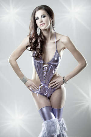 pretty brunette wearing purple party outfit on light background photo