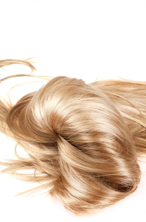 salon background: human blonde hair on white isolated background