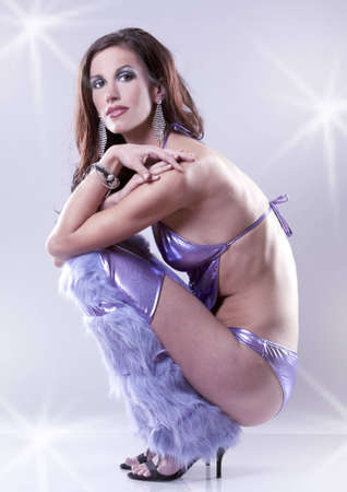 pretty brunette wearing purple party outfit on light background Stock Photo - 12649680