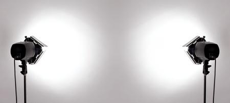 flash light: empty studio background and flash light on light grey