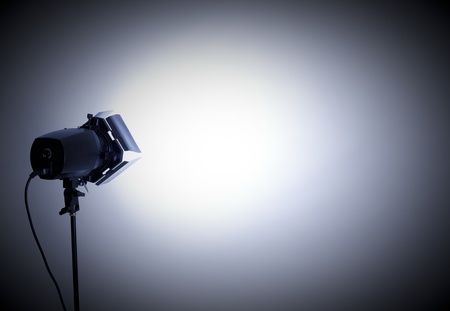 photography studio: empty studio background and flash light on light grey