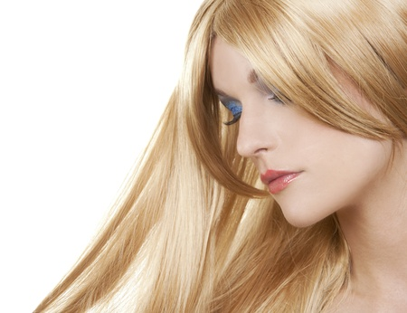 pretty blond woman with colorful makeup on white background photo