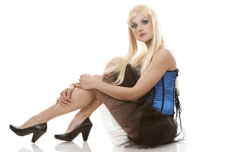 pretty blond woman wearing corset and black skirt on white background Stock Photo - 13135439