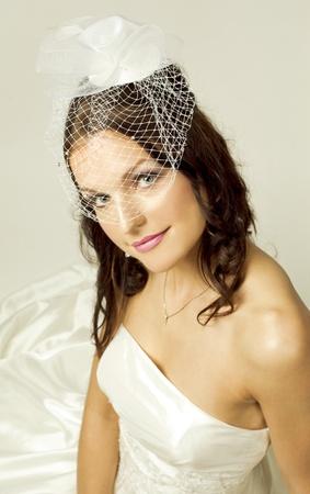 pretty brunette wearing wedding dress on light background Stock Photo - 13432280