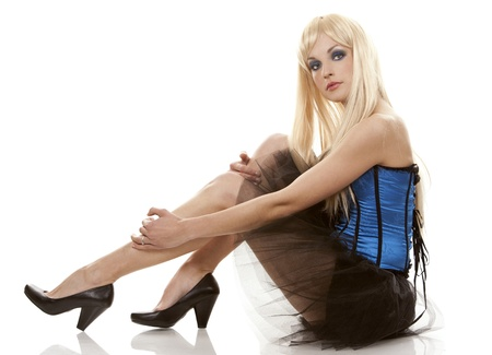 pretty blond woman wearing corset and black skirt on white background photo