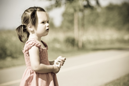 girl toddler is having fun in the summer photo