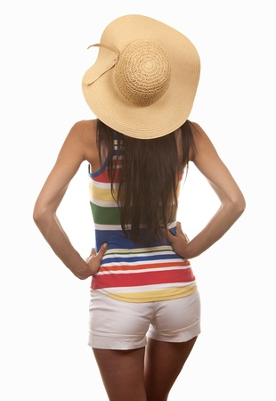 pretty brunette wearing summer outfit on white background