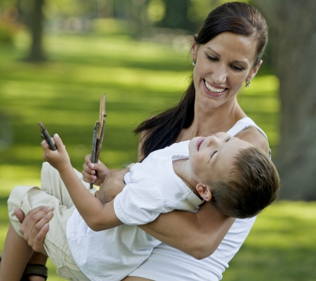 young mother playing with her son in the park Stock Photo