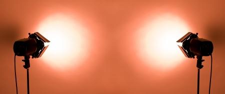 barndoor: empty studio background and flash lights on light red Stock Photo