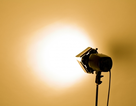 empty studio background and flash light on light orange photo