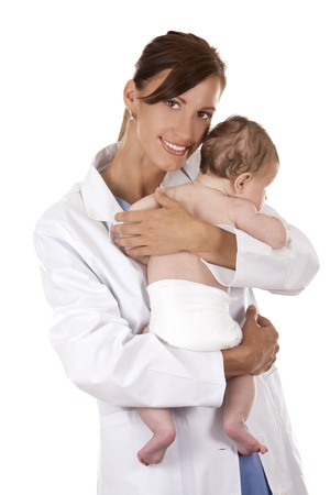 female doctor holding a baby on white isolated background photo