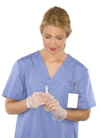 gloves nurse: beautiful blond healthcare worker wearing blue uniform scrubs