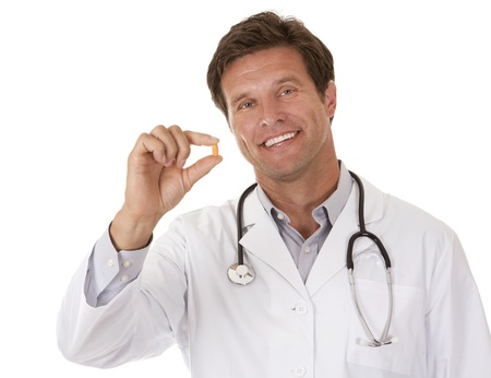 caucasian doctor is holding a pill on white isolated background photo