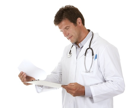 caucasian doctor is holding notes on white isolated background photo