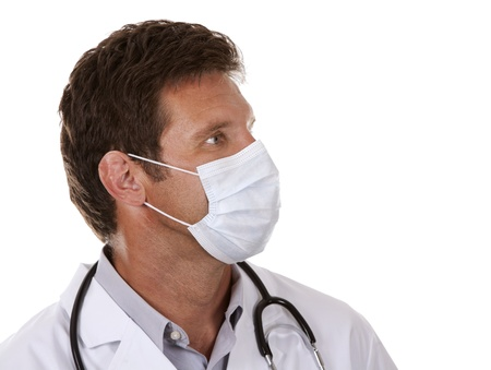 caucasian doctor is wearing a mask on white isolated background photo