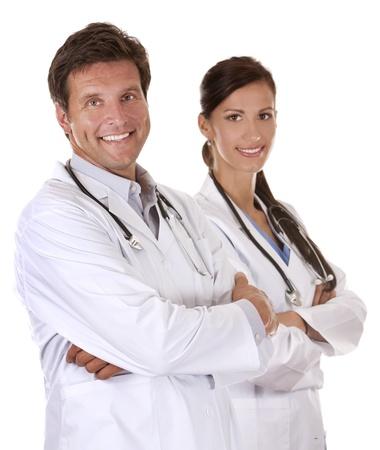 medico pediatra: los m�dicos est�n sonriendo en el fondo blanco aislado Foto de archivo