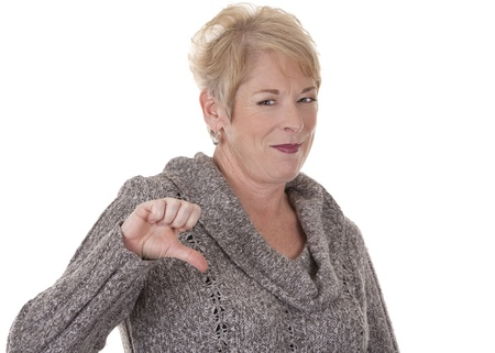 thumb down: casual blond woman in her fifties on white isolated background