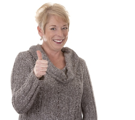 thumbs up woman: casual blond woman in her fifties on white isolated background