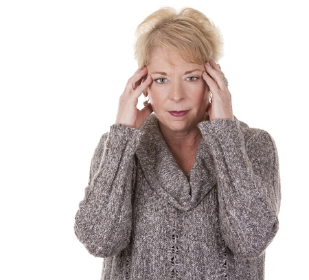 casual blond woman in her fifties having a headache
