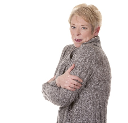 casual blond woman in her fifties is cold on white background Stock Photo - 15261190