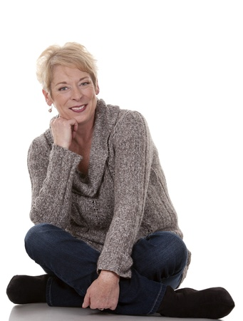 winter woman: casual blond woman in her fifties on white isolated background