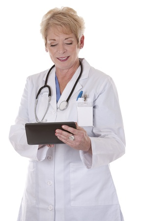 senior doctor holding tablet on white isolated background photo