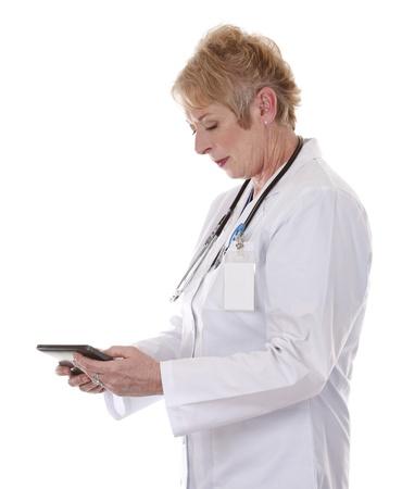 senior doctor holding tablet on white isolated background Stock Photo - 15358218