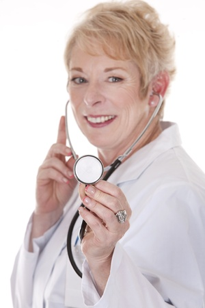 doctor listening with stethoscope on white isolated background Stock Photo - 15358226