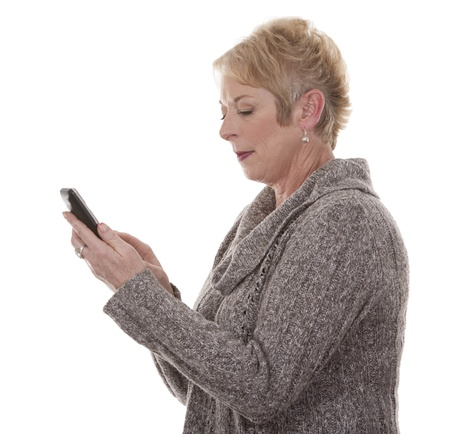 casual blond woman in her fifties using phone on white isolated background