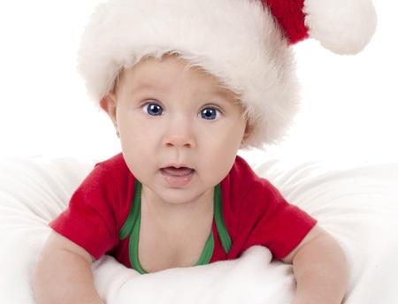 baby girl wearing santa hat on white isolated background Stock Photo - 15441266