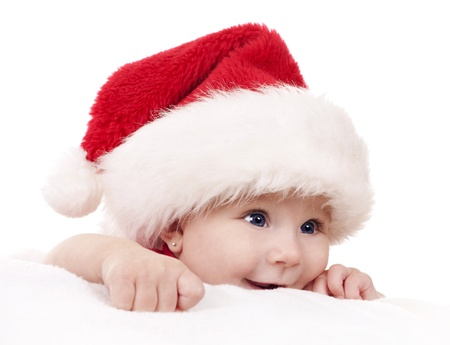 christmas costume: baby girl wearing santa hat on white isolated background