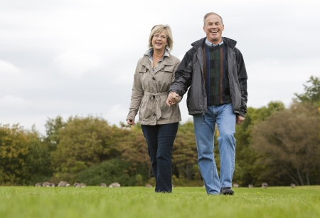 older casual couple sitting in the grass outdoors Stock Photo - 15562791