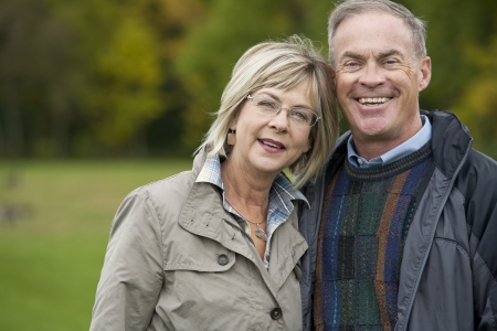 older casual couple sitting in the grass outdoors Stock Photo - 15562833