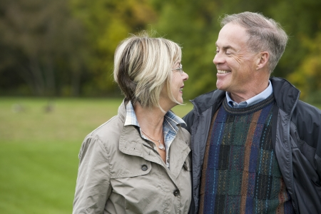 older casual couple sitting in the grass outdoors Stock Photo - 15562830
