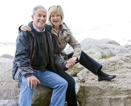 older casual couple sitting in the grass outdoors Stock Photo - 15562806