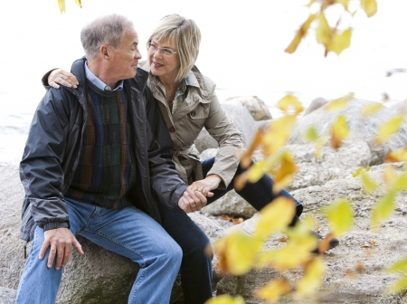 older casual couple sitting in the grass outdoors Stock Photo - 15562804