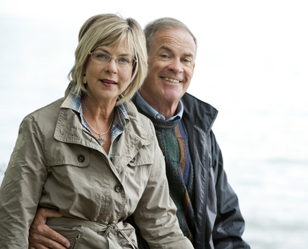 older casual couple sitting in the grass outdoors Stock Photo - 15562786