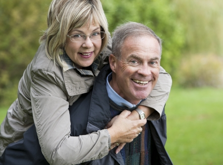 older casual couple sitting in the grass outdoors Stock Photo - 15562827