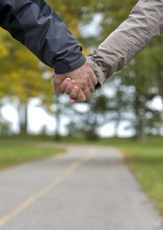 casual couple in their 60s holding hands together Stock Photo - 15599820