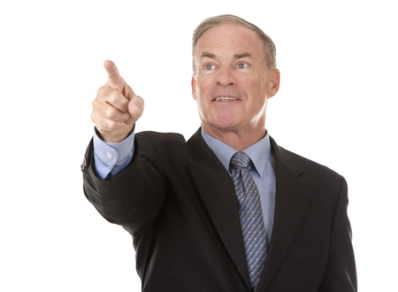 invisible object: senior business man is pointing at invisible object