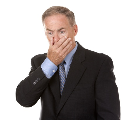 mature business man showing stress gesture on white background photo