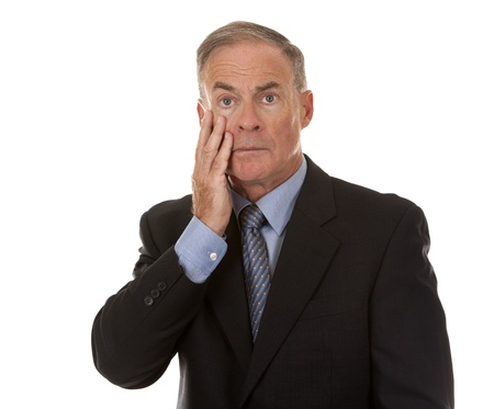 depressed man: mature business man showing stress gesture on white background