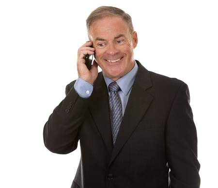 senior business man using cellphone on white background photo