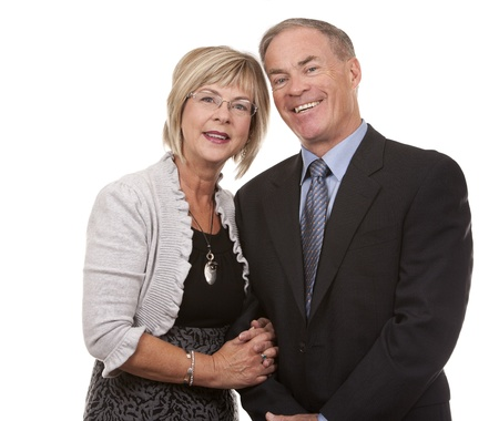 a pair of: formal couple posing together on white isolated background